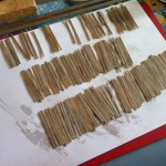 Stained stripwood made of stirring sticks, waiting to dry.
